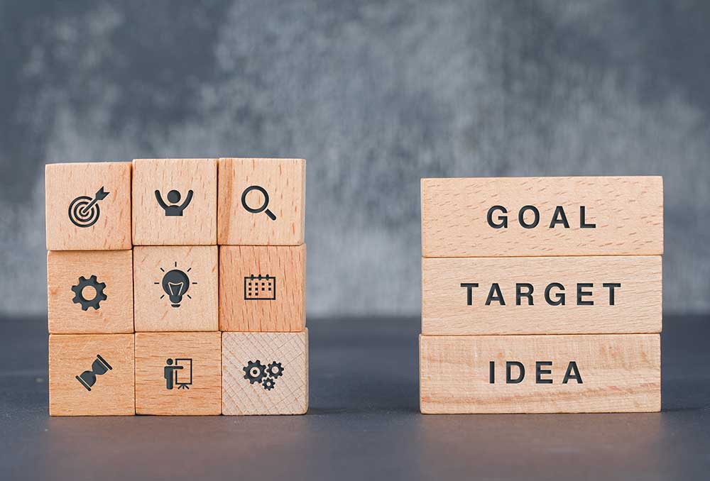 business-target-concept-with-wooden-blocks-with-icons-it-side-view