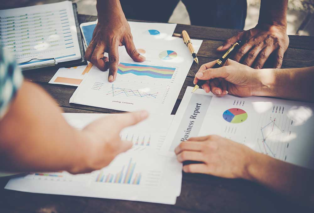 group-business-people-analysis-with-marketing-report-graph-young-specialists-are-discussing-business-ideas-new-digital-start-up-project
